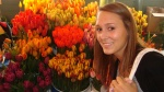 Sophia and the flowers at Pike Place Market